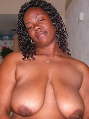 Big Black BBW Woman Modeling Nude And Spreading Thick Ass Cheeks
